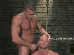 Submissive male is cuffed by a dominating man that fucks his asshole brutally