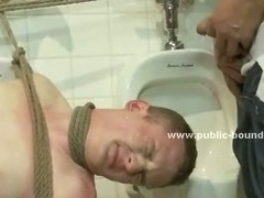 Blond boy gets tied up, blindfolded and fucked hard in the ass after sucking off a bunch cocks