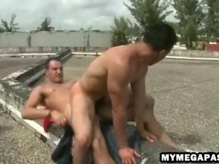 Porno Video of Two Dirty Hunks Sneak On To A Roof Top To Bareback