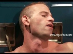 Muscular and blindfolded gay man is tied up to a locker and gets his torso caressed