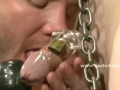 Chained and blindfolded slave gets his cock teased with a riding crop and has his asshole fucked