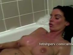 Beautiful brunette Carmen takes naughty bubbles bath