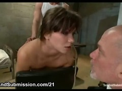 Btunette in bondage gets ass plugged and throat fucked by two dicks