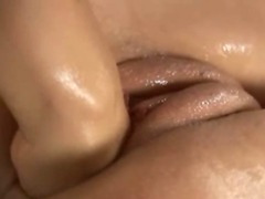 Beautiful lesbians deep pussy fisting as the lips stretch over a slender girls wrist