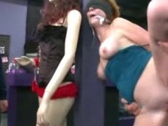 Redhead gets gangbanged in adult store