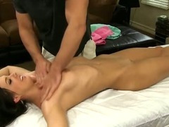 Very Hot Brunette Rubbed Down On A Massage Table