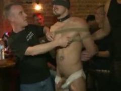 Blindfolded guy gangfucked in bar