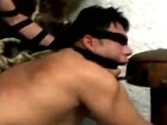 Blindfolded guy sucks tranny dick