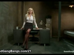 Busty blonde prison warden gangbanged by group of horny inmates