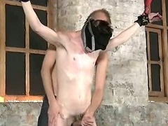 Blindfolded stud gets covered in some hot wax