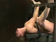 Strapped to metal device babe ass fisted and hard whipped