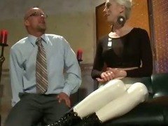 Blonde in tight white pants flogs tied up guy and cuts off his business suit