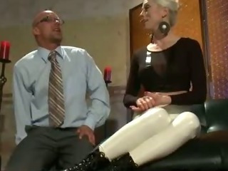 Porno Video of Blonde In Tight White Pants Flogs Tied Up Guy And Cuts Off His Business Suit
