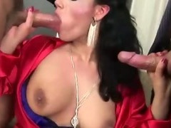 Glam clothed whore eats two