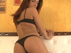 Sexy brunette tranny gets naked and tugs her cock