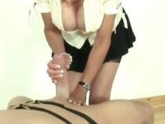 Mature femdom fetish slut giving oily handjob
