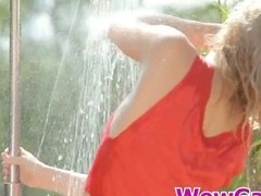 Pretty Madonna loves wetting her self with a shower.
