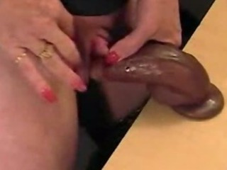 Porn Tube of Mature Masturbates Big Clit With Black Dildo