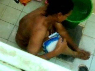 Porno Video of Bathing Aunty Caught In Cam