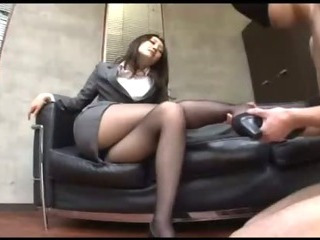 Porno Video of Office Lady In Pantyhose Sitting On The Couch Giving Footjob For Blindfolded Guy In The Office