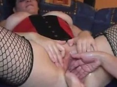 Double fist fucking her huge vagina