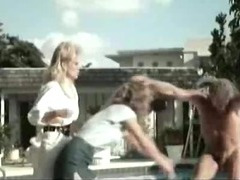 Vintage threesome action near the pool in retro porn movie