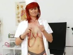 Attractive redhead cougar nurse solo