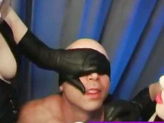 Captivated man slave tongue punnished with leather gloves