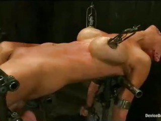 Porn Tube of Busty Babe Bound In Metal Flogged And Vibed