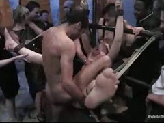 Tied to metal bars babe orgy fucked