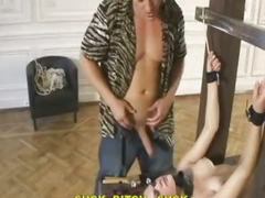 Restrained babe gets her shaved pussy whipped and her face fucked