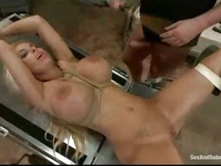 Porn Tube of Bound Blonde Fucked In Gynecological Table