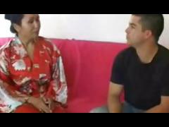 Naughty asian masseuse gives soapy handjob