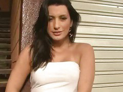 Latina tranny tugging on her hard cock outdoors