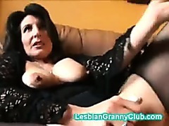 Horny granny brunette masturbates with a really big dildo