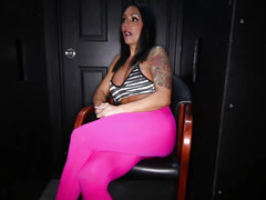 Busty Buff MILF giving blowjobs to strangers in a gloryhole booth and swallowing cum