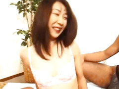 Japanese milf sucks hard penis while getting doggy style