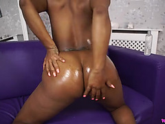 British darksome cutie coats her melons and arse with oil