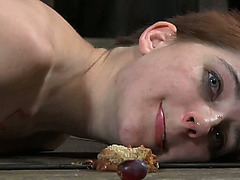 Red haired sex-thrall is eating food from messy floor