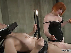 Redheaded bitch goddess burns her blond thrall with wax