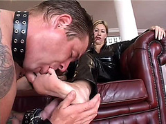 This Guy licks the feet of the latex woman
