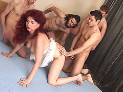 Older redhead Janna in a Gang Team Fuck