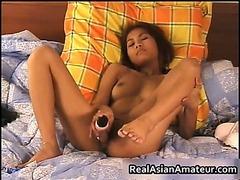 Asian cutie spreads her cunt 8