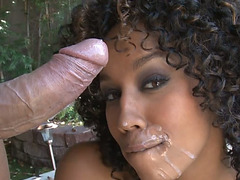 Chocolate sweetheart receives milky goo on her face after ramrod engulfing outdoors