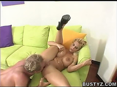 Holly Halston receives it on a large green sofa