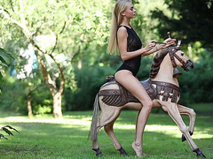 Fantasy angel Nancy A riding large sex toy on a lawn outdoor