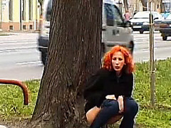 Older redhead taking a piddle in a public park