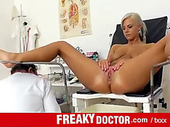 Undressed blond patient examined by her doctor