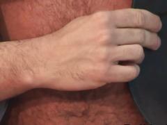 Brawny leather bear pulling his hard 10-Pounder