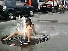 Exposed honey washing her vagina on the street